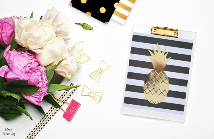 DIY Gold Foil Pineapple Print on a Black and White Striped background. A fun and easy tutorial.