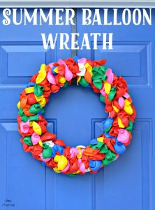 This fun and happy summer balloon wreath is the perfect item to adorn your front door!