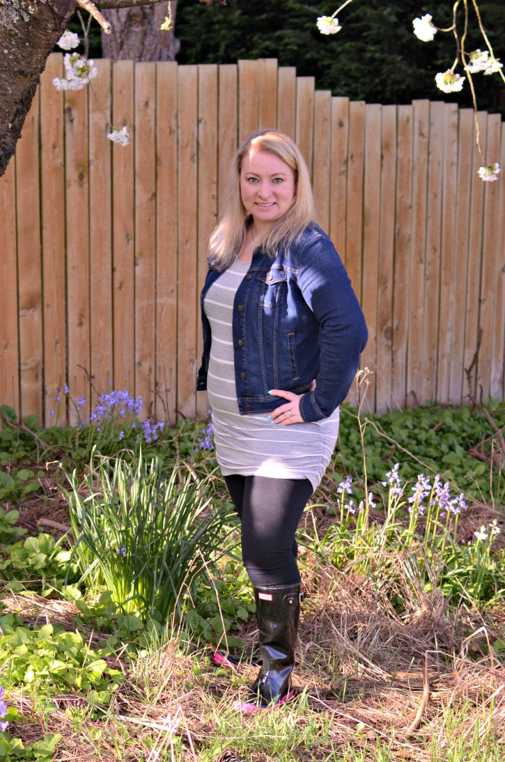 An outfit featuring Black & Pink Hunter Rain boots, black leggings, a striped dress, and jean jacket