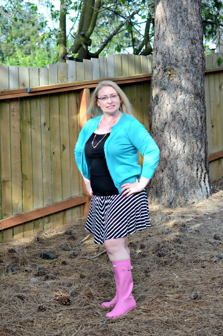 e62202aeb An outfit featuring pink hunter rain boots, striped knit skirt, and teal  cardigan