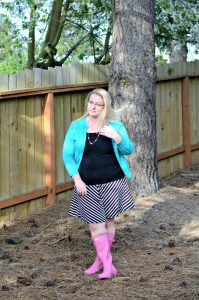 An outfit featuring pink hunter rain boots, striped knit skirt, and teal cardigan