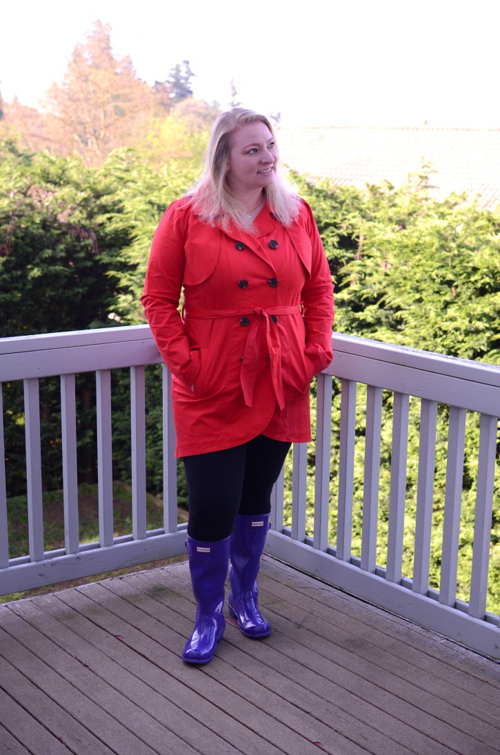 A spring outfit featuring purple hunter rain boots and a red rain jacket