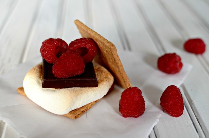 Gourmet s'more with chocolate and raspberries