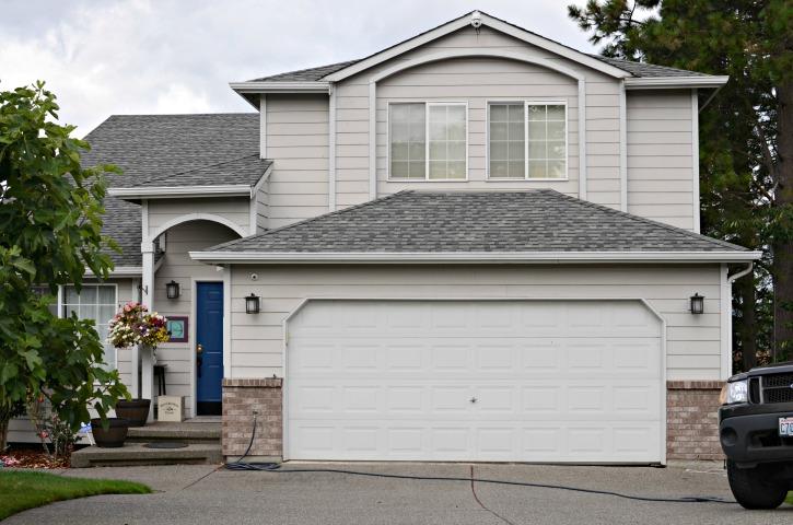 House before added garage door windows