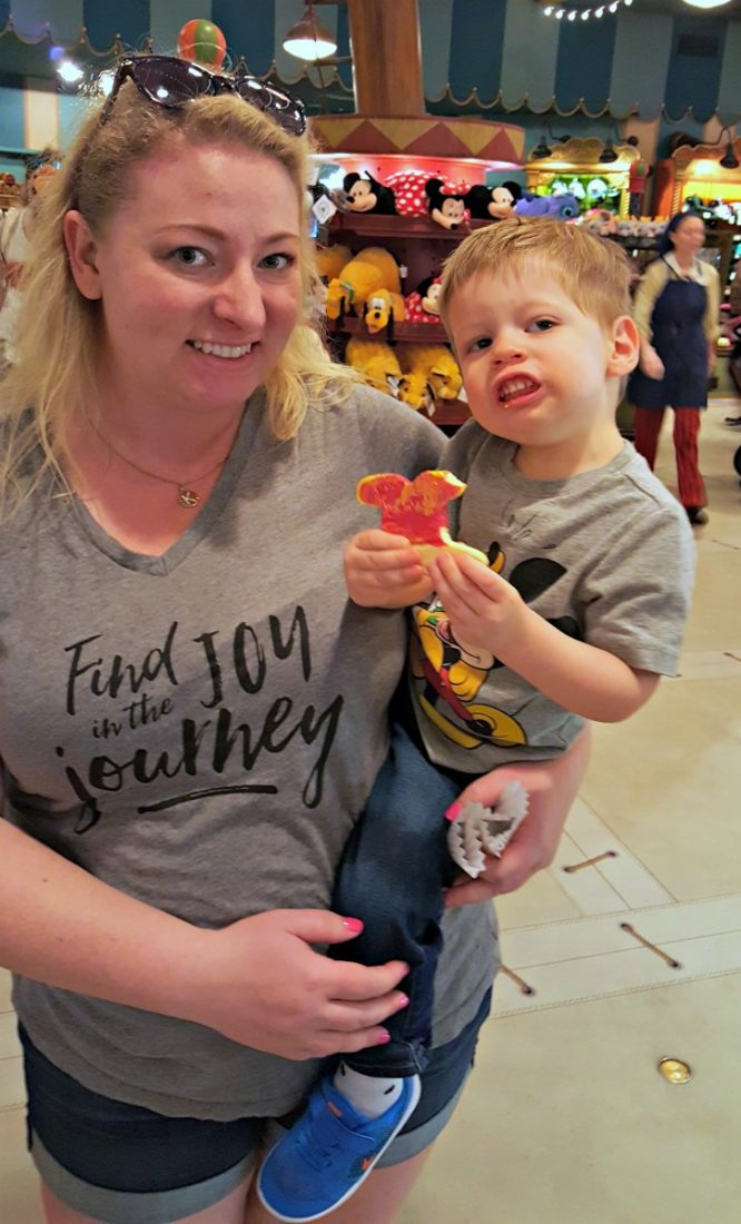 Toddler with cookie at Walt Disney World Magic Kingdom