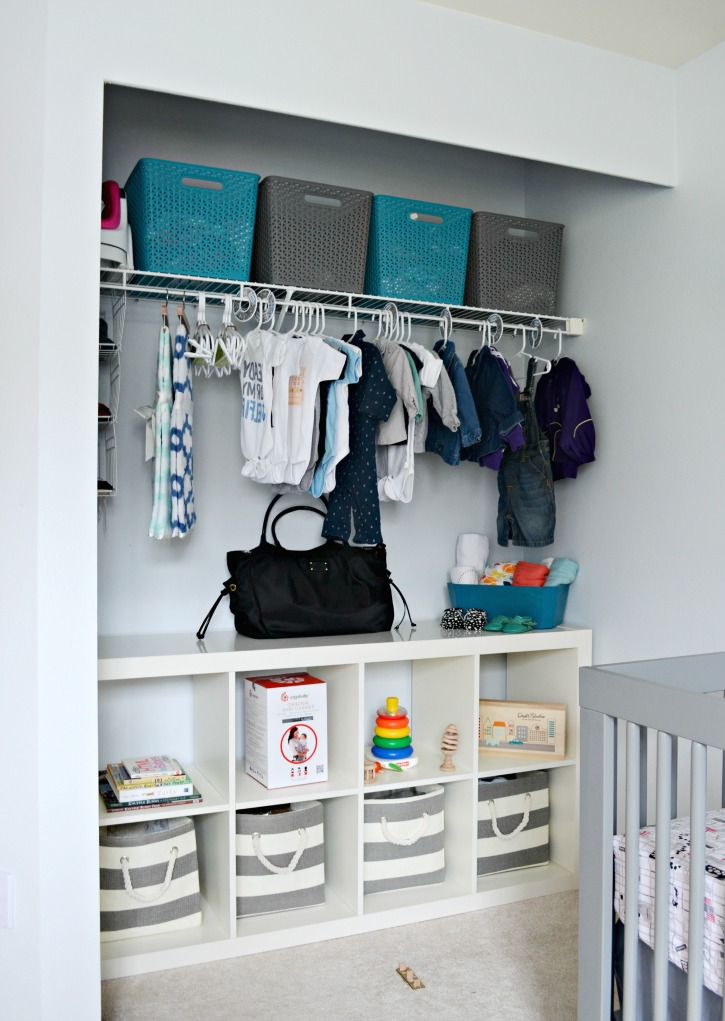 An Organized Grey White Nursery Closet