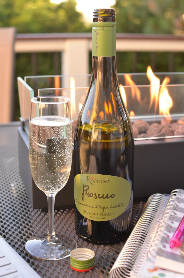 Prosecco with firepit in the background