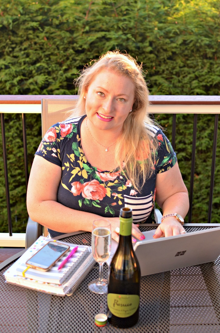 Woman at computer with prosecco and laptop