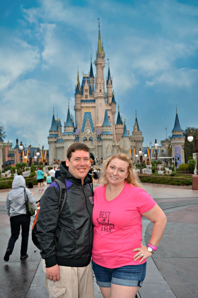 Couple in front of the castle at Walt Disney World Magic Kingdom