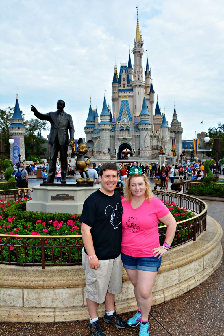 Couple at Magic Kingdom in front of the castle