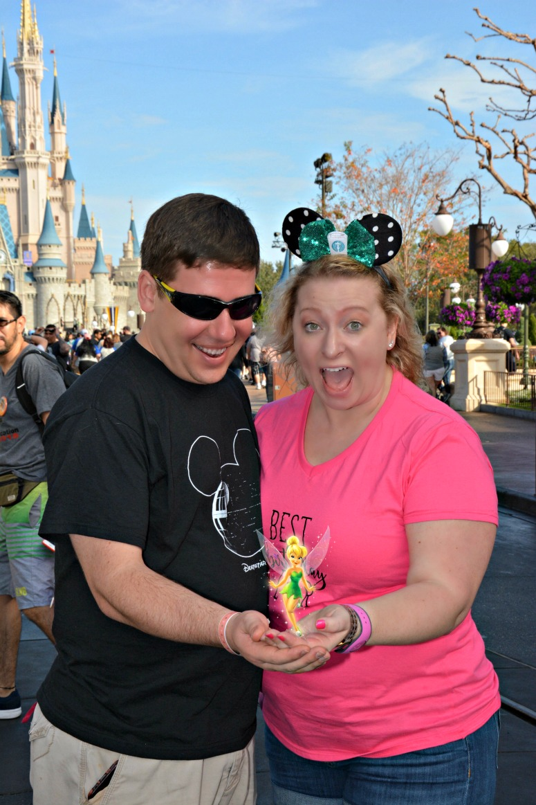 Couple at Magic Kingdom with Tinkerbell