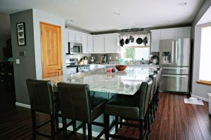 White Kitchen Cabinets with Granite and Large Center Island