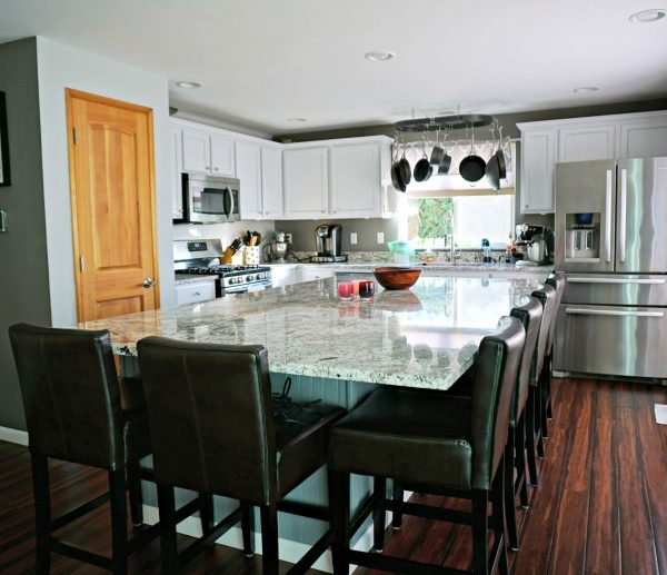 Updated White Kitchen With Large Center Island