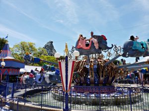 Dumbo Ride Disneyland with Matterhorn in background