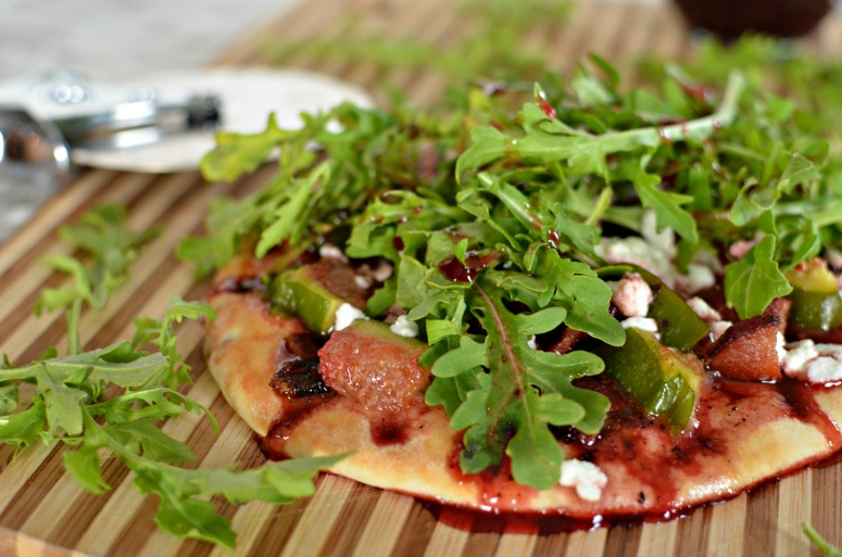 Flatbread featuring bacon, arugula, figs and goat cheese