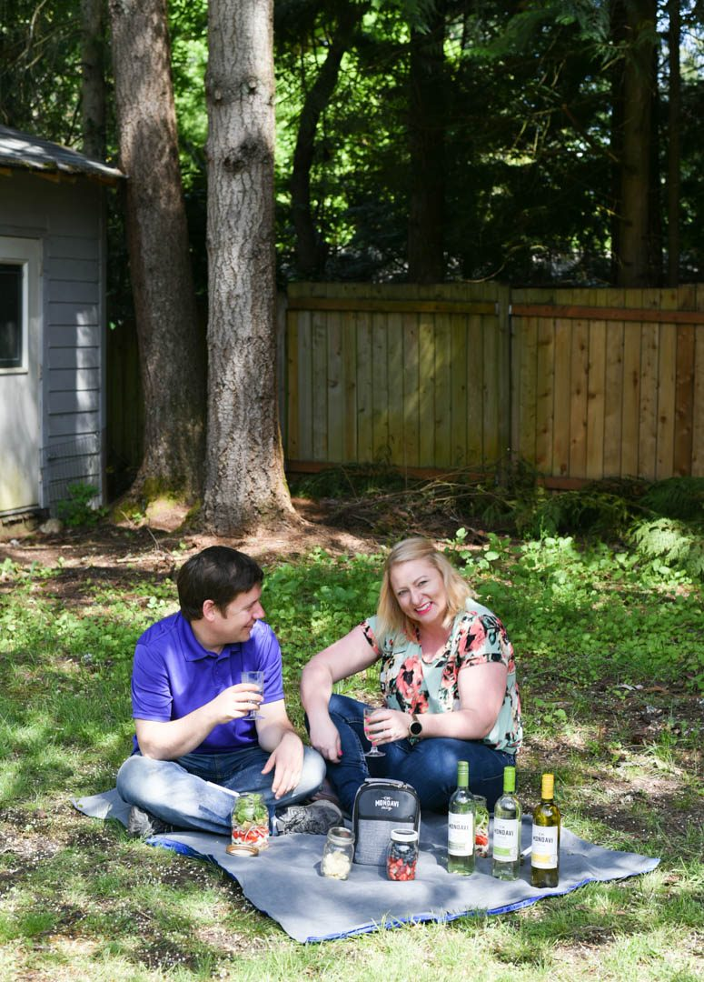 Couple having a backyard picnic