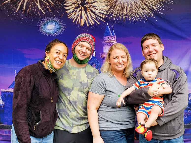 Family Photo in front of Disneyland Castle Backdrop