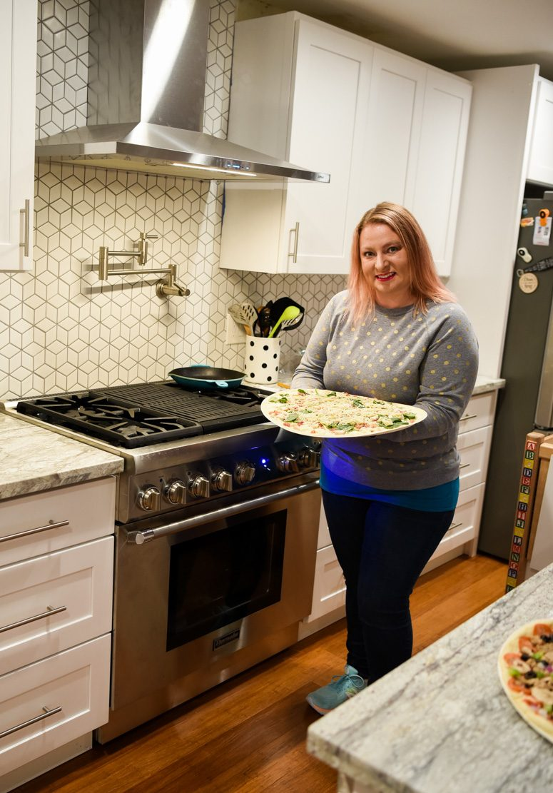 Woman holding Papa Murphy Pizza in Kitchen