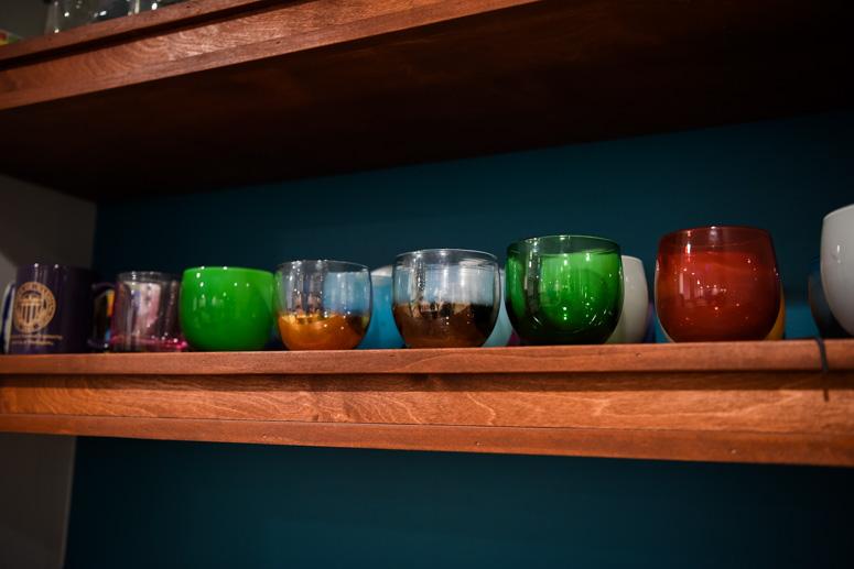 Glassybaby drinkers on wooden shelf