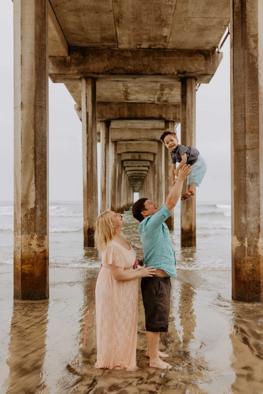 Family under an ocean pier