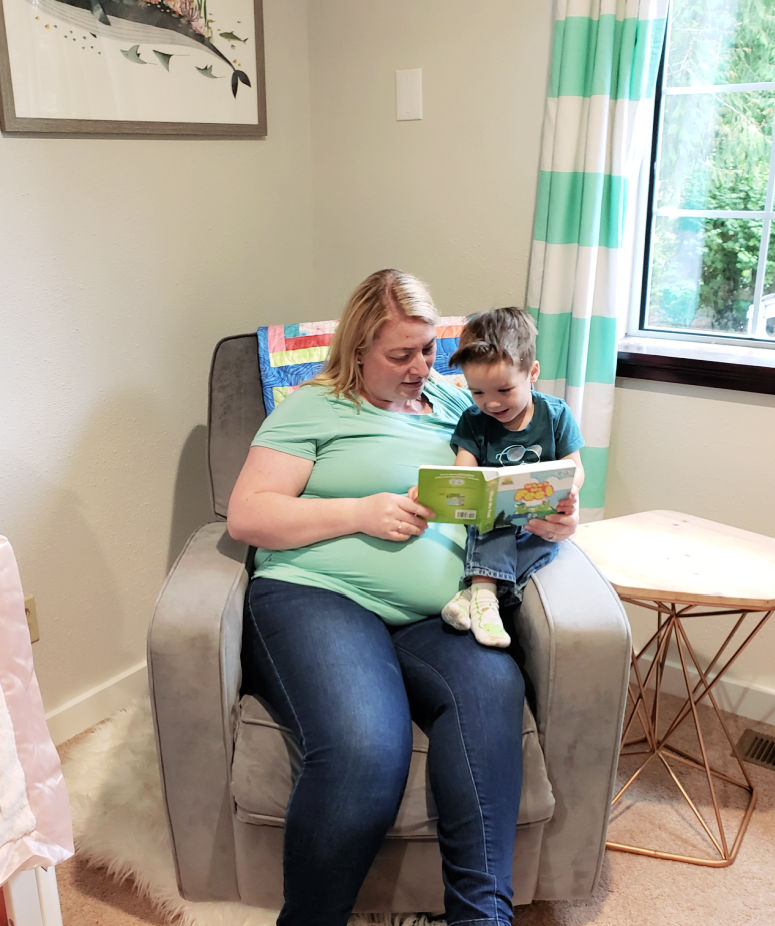 Mom and Toddler Reading in Nursery